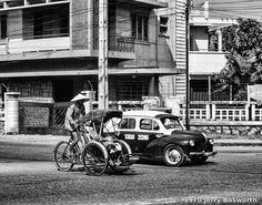 Cyclo (traditional three-wheeled bicycle with a carriage at the front for passengers) and taxi back in the old days of Southern Vietnam (Photo: Jerry Bosworth)