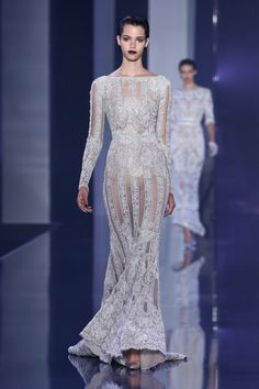 Metallic silver French Chantilly lace fishtail gown with pearl and crystal embellishment.