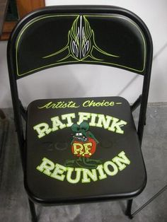 Someone painted Pinstripes and Rat Fink on a metal foldind-chair