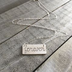 Finally got new pictures! I am definetly not good at it #buttryingreallyhard.  This is my new forever necklace made of fine silver and hand stamped. I will customize the length of the necklace as you need it. Great present for yourself don't you think?  Not available on my Etsy store yet so send me a message to order it ##################### Valentine's Day is almost here but still have time to get your necklaces if shipped today! . . . .  #forever #loveyou #Loveland #loveu #loveisintheair…