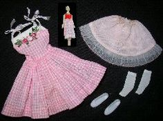 Vintage Skipper Me N My Doll #1913 (1965 - 1966)  Pink and White Gingham Check Dress  Pink Nylon Slip With White Lace Trim  White Flat Shoes  Miniature Barbie Doll With Matching Gingham Skirt White Ankle Socks  Skipper's pretty pink and white gingham checked sundress has ribbon straps that tie at the shoulder.  It has a floral applique.  The dress is fairly easy to find, but the miniature Barbie, her skirt and the slip to this ensemble can be very hard to find.