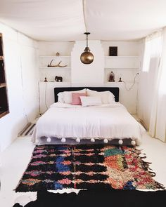 Bedroom with white tapestry on ceiling. Total tent vibes