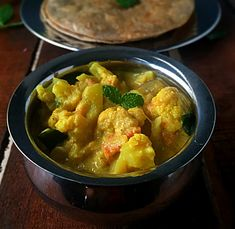 Make this delicious Tamil Nadu restaurant style cauliflower chops with… Curry Recipes, Veggie Recipes, Indian Food Recipes, New Recipes, Ethnic Recipes, Vegetarian Recipes, Cauliflower Kurma Recipe, Cooking Dishes, Cooking Recipes