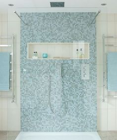 Time For Reflection When You Think Of A Rejuvenating Bath, Blue Immediately  Comes To Mind. This Mosaic Tiled Shower Feels Open, Refreshing, And Cool.