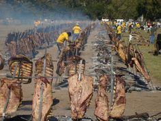 """muchos asados al """"""""asador""""""""( se estaca la carne en pinches en forma de cruz), aca es en un festejo pampeano, bien a puro campo"""