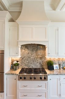 range hood. Don't need the chimney so much as a higher cabinet. Love the drawers under the range.