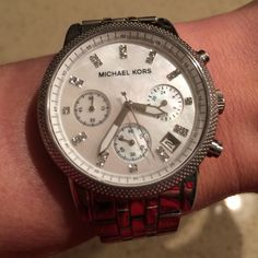 Michael Kors Watch MK5020 Michael Kors women's watch MK 5020. Stainless steel watch with diamond like accents. In great condition and very well taken care of. Comes with box and I may have the original receipt still. Michael Kors Jewelry