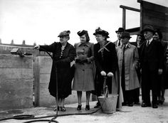 1940: Firefighting demonstration for housewives using a stirrup pump to combat the use of incendiary bombs which the Germans were dropping on London (Photo by Popperfoto/Getty Images)