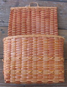 "Cherokee letter basket, plaited with maple splints in natural, pale red, and orange red, North Carolina, mid 20thC, the original sales tag from the Ocmulgee Mounds Museum Shop in Macon GA, identifies the material as maple, and the weaver as ""Mary Lassick, E. Cherokee"", near mint condition"