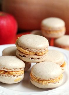 Ginger macarons team up with pumpkin bourbon buttercream to make a sandwich cookie that is perfect to round out any fall feast!