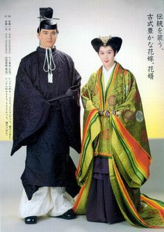 A couple dressed in heian era robes.