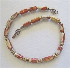 Red Jasper Gemstone and Bronze Necklace    One of Miriam's unique, one-of-kind designs, this sleek and sophisticated natural Red Jasper and Bronze natural stone necklace is designed to be worn all year round - and for any occasion. Each stone has a different natural pattern in hues of rusty-red, beige and a touch of gray. $205 on Etsy