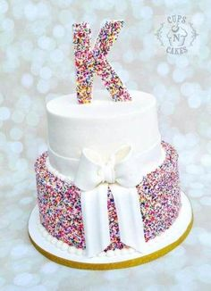 Sprinkles Cake & marble cake with vanilla buttercream. Fondant bow and letter. Sprinkles to bottom tier and letter topper. Thanks for looking :) ~April Rainbow Sprinkle Cakes, Rainbow Sprinkles, Cake Rainbow, 13 Birthday Cake, Birthday Cakes For Teens, Pretty Cakes, Cute Cakes, Fondant Bow, Buttercream Fondant