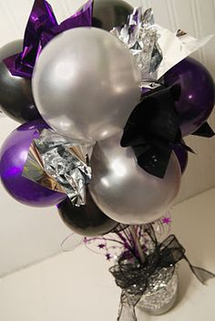 Cute balloon topiary centerpieces. No helium required!  Pride fundraiser?