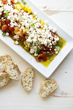 Easy Goat Cheese Appetizer recipe from @dineanddish - If you have five minutes to spare, you have enough time to make this easy appetizer. It's a fancy looking dish without a lot of fuss. Plus, it tastes great, is a delicious combination of savory and sweet, and it makes a beautiful presentation.
