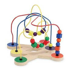 Melissa and Doug Bead Maze - Multi-shaped and brightly colored beads swoop along wires to encourage color/shape recognition and fine motor development - the Melissa and Doug Bead. Toddler Toys, Baby Toys, Kids Toys, Children's Toys, Lego Sets, Wooden Educational Toys, Activity Toys, Activity Board, Melissa & Doug