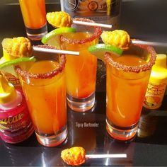 """MINI MANGONEADA SHOTS 1 1/2 oz (45 ml) Silver Tequila 1/2 oz (15 ml) Triple Sec 3 oz (90 ml) Mango Juice/Puree 1 oz (30 ml) Lime Juice 2 Dashes Tapatio Hot Sauce Lucas Gusano Chamoy (Mexican Candy) Mango (del puesto) Chili Powder Lime  Mexican Mini Mango Lollipop Pour all ingredients into a shaker with ice Shake & strain into a shots glass  Rim with the chili mango powder inside the candy bottles Coat the inside of the glass with """"chamoy"""" Lucas Gusano (Mexican Candy) Garnish with Lime and…"""