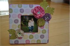 June 2011 Jamie's June Feature - a wooden frame covered with scrapbook paper and paper flowers