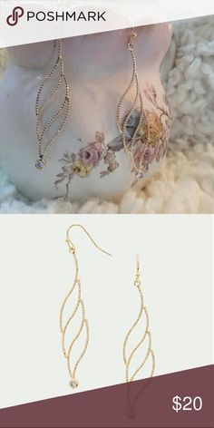 """NWT Gold and Austrian Crystal Earrings NWT, beautiful and delicate, these gold-tone earrings have a long 3-leaf shape with a round Crystal at the bottom. Shiny and expensive looking. Can be worn casual or dressy. Fish hook backs, 0.5 W x 2.75"""" L. Jewelry Earrings"""