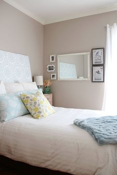 A very light touch of colour on the wall, coupled with pastels and neutrals