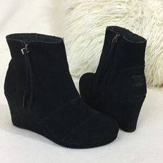 """TOMS Like New black suede wedge ankle boots TOMS Like New black suede wedge ankle boots. Gorgeous black suede with side zipper for easy on/off.  These were only worn around the store and are in wonderful condition. Pretty much new. 3 1/4"""" suede wrapped wedge   Insoles measure 9"""" long for reference.  Total boot height including heel is 8"""". TOMS Shoes Ankle Boots & Booties"""