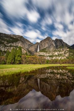 On a moon lit night, I photographed Yosemite Falls as storm clouds streaked by. The starry sky can be seen through the moving clouds as the entire landscape is reflected in a flooded meadow in Yosemite Vally.