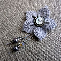 crocheted flower with beads & buttons ... make a pin or add a crocheted long tail ending in beads for a bookmark ... no tutorial