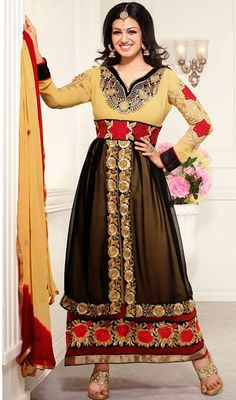 As enchanting as Ayesha Takia is how you will look in this black and cream georgette layered churidar suit. This beautiful attire is showing some extraordinary embroidery done with floral patch, lace and resham work.  #LatestBollywoodFancyAnarkaliDress