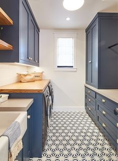 Blue Laundry Room Inspiration: Navy Laundry Room Cabinets painted in Dunn-Edwards Outer Space and flooring covered in navy and white cement tile Navy Laundry Room Navy Cabinet White Laundry Rooms, Mudroom Laundry Room, Laundry Room Shelves, Laundry Room Remodel, Laundry Room Cabinets, Laundry Room Organization, Laundry Room Design, Laundry Room Floors, Bathroom Cabinets