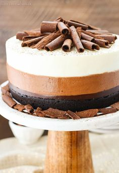 This Triple Chocolate Mousse Cake is an amazing combination of chocolate cake, chocolate fudge, and chocolate and white chocolate mousse! It's smooth and creamy layers of mousse on top of a rich, moist cake. So good!