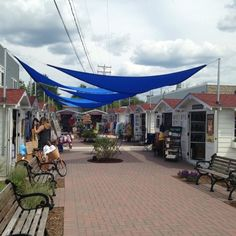 """During warmer months, check out a series of """"pop-up shops"""" in Walloon Lake Village, where you'll find crafts, clothing, and everything in between. Vacation Places, Vacation Spots, Places To Travel, Places To See, Vacation Ideas, Travel Destinations, Greece Vacation, Dream Vacations, Michigan Vacations"""