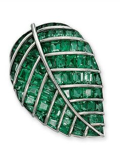 """AN EMERALD """"FEUILLE DE LILAS"""" BROOCH, BY BOIVIN  Set with calibré-cut emeralds between raised platinum veins, circa 1936, 4.5 cm long, with French assay marks for platinum and gold By Boivin"""