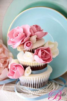 Tiered Cupcakes: how cute! jumbo, regular, and mini cupcakes stacked together - adorable