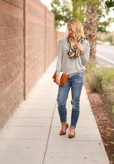 Cold shoulder top, boyfriend jeans, lace-up flats and infinity scarf. Women's fall fashion idea.