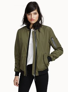 A Canadian design by Mackage at Simons - The military look is this season's top trend! - Faux-leather accent and contrasting black ribbed trim - Polyester fabric with a shiny, satiny finish - Slant zip pockets - Full-length zip The model is wearing size small