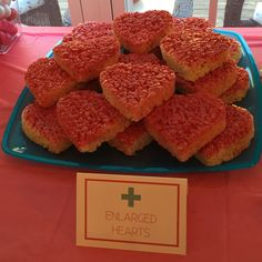 These are rice Krispy treats cut out into the shape of hearts with a cookie cutter then spray painted with edible food spray. Nurse Grad Parties, Nursing School Graduation, 13th Birthday Parties, Graduation Party Decor, Graduation Ideas, Retirement Party Decorations, Retirement Parties, Medical Party, Nursing Party