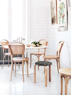 White kitchen tiles and leather chairs