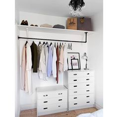 Putting a shelf above the chest of drawers might be a good plan - could run from wall with door to pier.