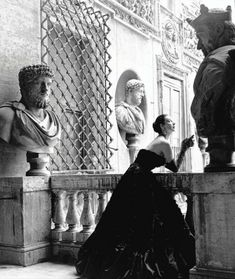 Model Dorian Leigh wears a Simonetta Visconti evening gown on a Rome balcony. 1952.