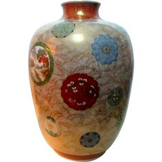 This is an exceptional LARGE Antique Japanese Imari porcelain vase of the MEIJI period The ground is hand painted in gold with clouds and waves
