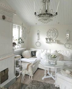 Fannyromantic. I'm seeing elements of Boho, Victorian, Shabby Chic, Farmhouse, Cottage and Vintage. Absolutely Stunning! White Brings it all together! Great Decorating Ideas!