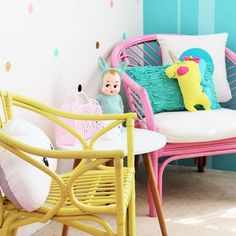 Love the bright coloured rattan chairs