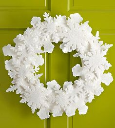 Felt Snowflake Wreath: Snowflakes cut from fluffy white felt help decorate a melt-free wreath that can be displayed all winter long. It looks perfect hanging on a door