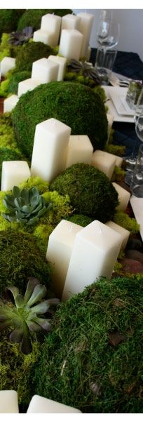 Gorgeous moss and pillar candles tablescape