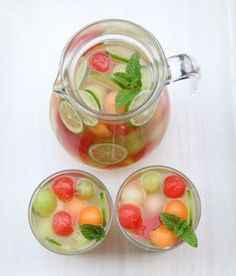 Combine moscato, grappa, fresh melons + mint to make this Melon White Sangria.