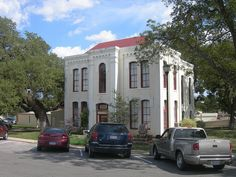 Wilson County Jail in Floresville, Texas-In use until 1974, the white brick and stucco cubic jail was designed in 1887 by James Riely Gordon and built at the NE corner of the square.[7] Contractor B.B. Reid erected the building for $14,000. General living quarters are on the ground floor, with the prisoner cells on the second floor separated from the second-floor bedrooms.The Wilson County Courthouse and Jail are located 1420 3rd St Floresville Tx