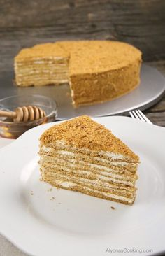 Honey Cake Recipe (Medovik) Russian-Store CopyCat Our local Russian Store sells these amazingly soft, spongey and thin cake layers that make for one of the most delicious honey cakes sold in the area -Medovik. Russian Honey Cake, Russian Cakes, Russian Desserts, Russian Recipes, Armenian Recipes, Honey Cake Recipe Easy, Honey Recipes, Dessert Crepes, Birthday Cakes