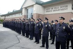 #FallRiver police officers line the front of the police station at the fallen officers memorial dedication.