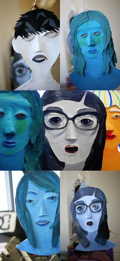 Cardboard and paper-mache faces.... a fun project idea for those extra hangers! via frecklephotoblog