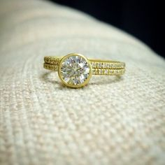 Custom Wedding Set crafted in brushed 14K Yellow Gold holds a Round Cut  1.0ct MiaDonna